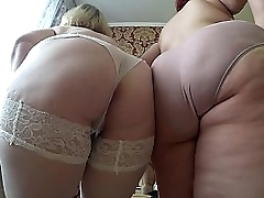 Mature girlfriends undress each other, shaking big tits and thick butt. Lesbians bbw.