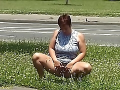 redhead bbw milf peeing on public street while she sucks her big natural breasts